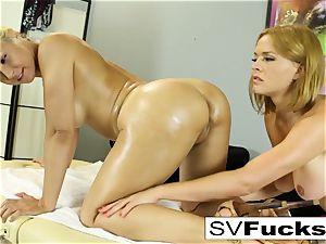 Sarah gets a deep tissue rubdown from Krissy