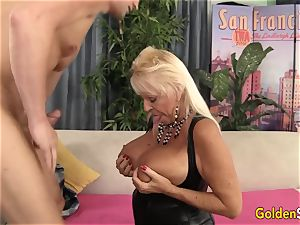 Floppy breasted grandma romps a smooth-shaven boy