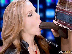 Julia Ann has a taste of a meaty dark-hued man-meat