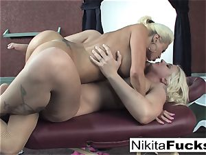 Nikita gets a calming rubdown from Leya