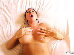 huge-chested Russian GILF busts all over penis