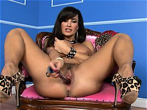 fantastic Lisa Ann catapults her fake penis deep in her moist poon