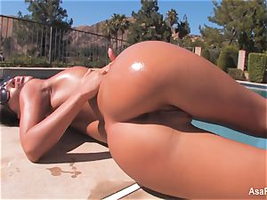 Everyone's fave adult movie star Asa taunts by the pool