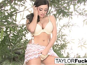 Taylor plays with her honeypot outdoors