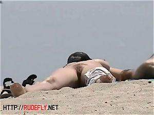 big-boobed naked beach honeys filmed by a hidden cam